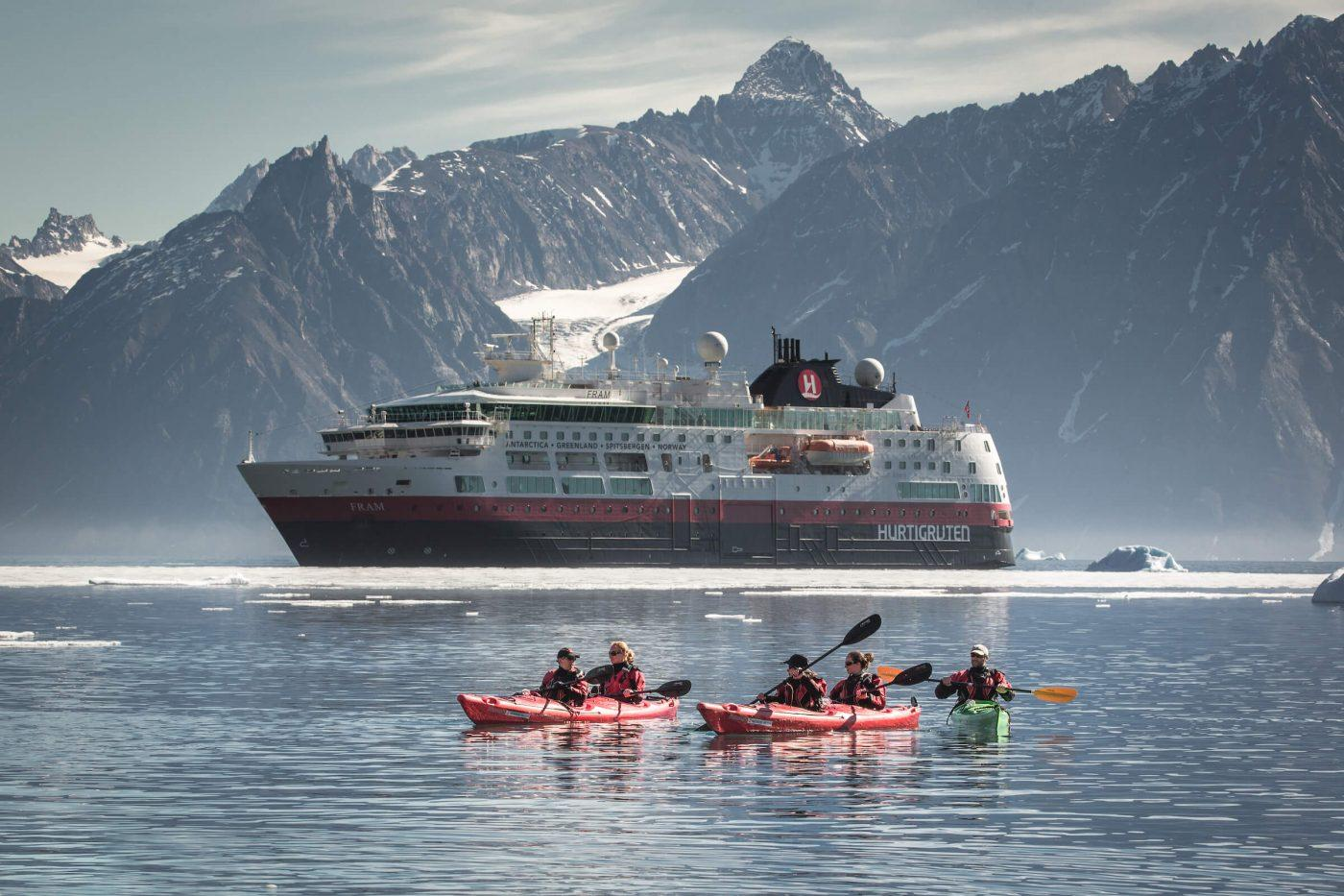 Kayakers in front of MS Fram in North Greenland near Illorsuit. By Mads Pihl