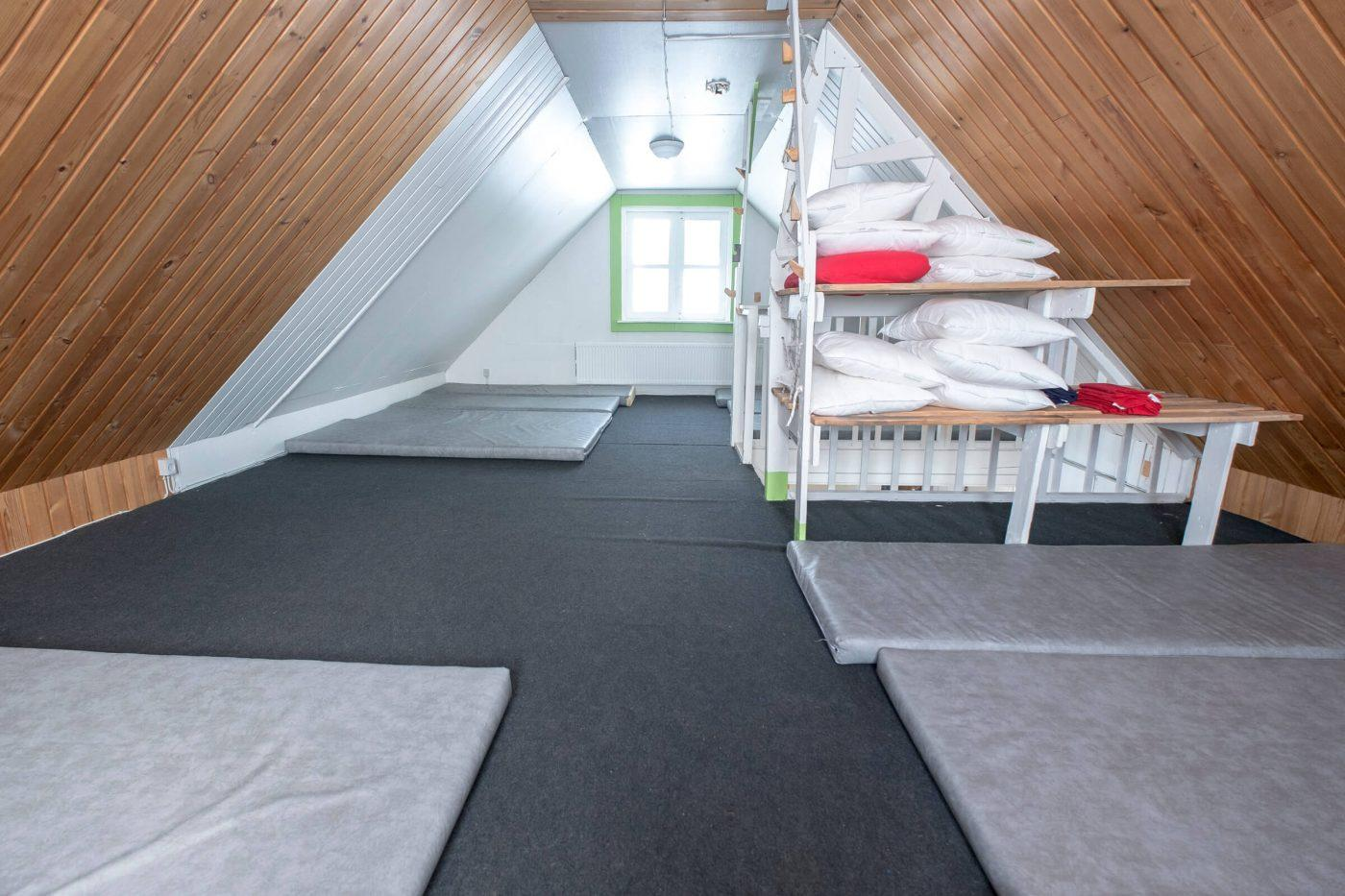 The top floor is a sleeping loft with a mountain-hut style sleeping bag accommodation in a dormitory for up to 15 persons. Photo by Icelandic Mountain Guides