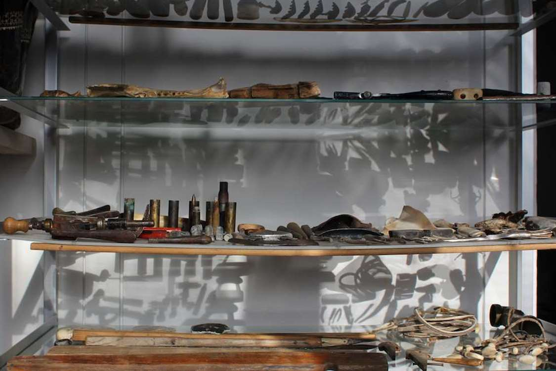 The collection in this shelf is from Justine's father, Jaappili: All sorts of small things for hunting, reparation, playing etc. The collection inspired Justine to establish the museum. Photo by Kulusuk Museum