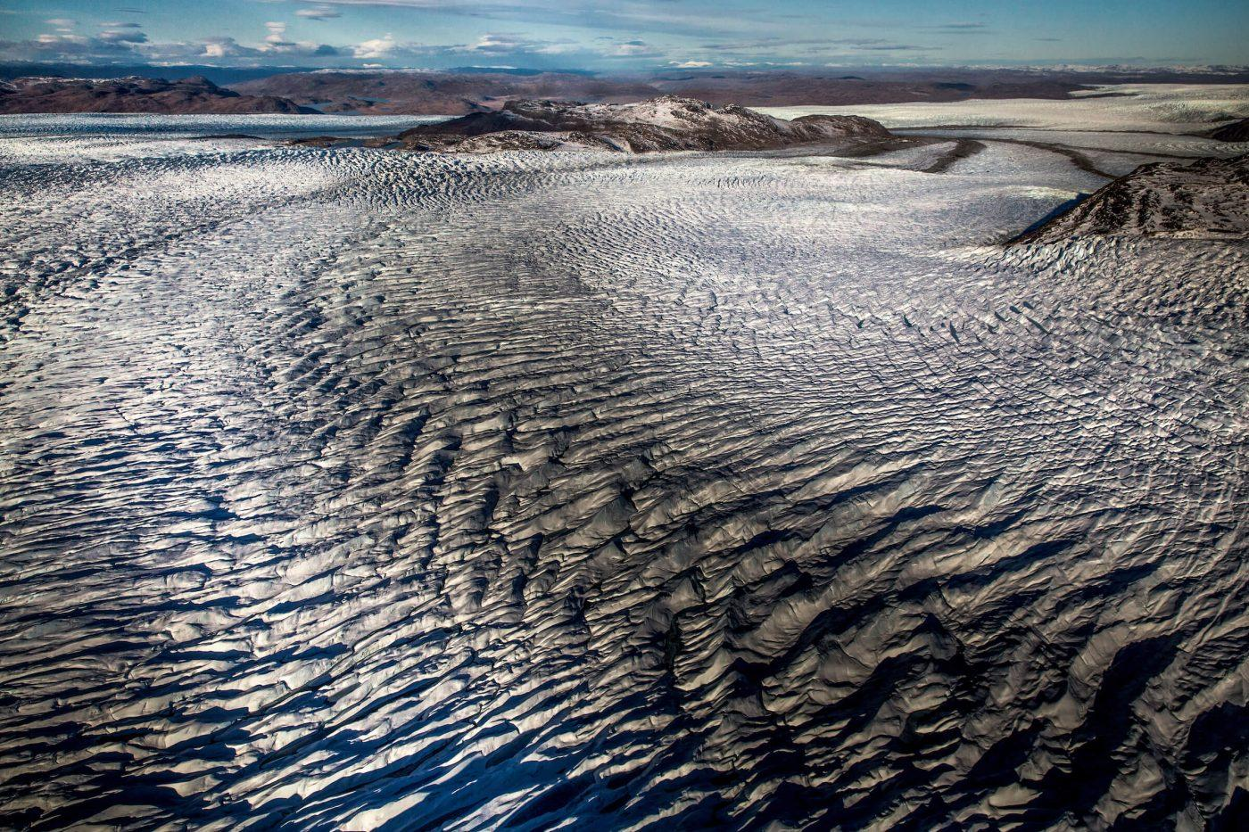 Lines in the ice sheet seen from an Air Zafari flight near Kangerlussuaq in Greenland. By Mads Pihl