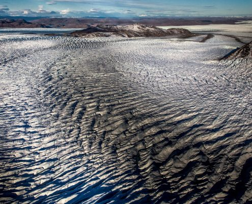 Lines in the ice sheet seen from an Air Zafari flight near Kangerlussuaq in Greenland. Photo by Mads Pihl