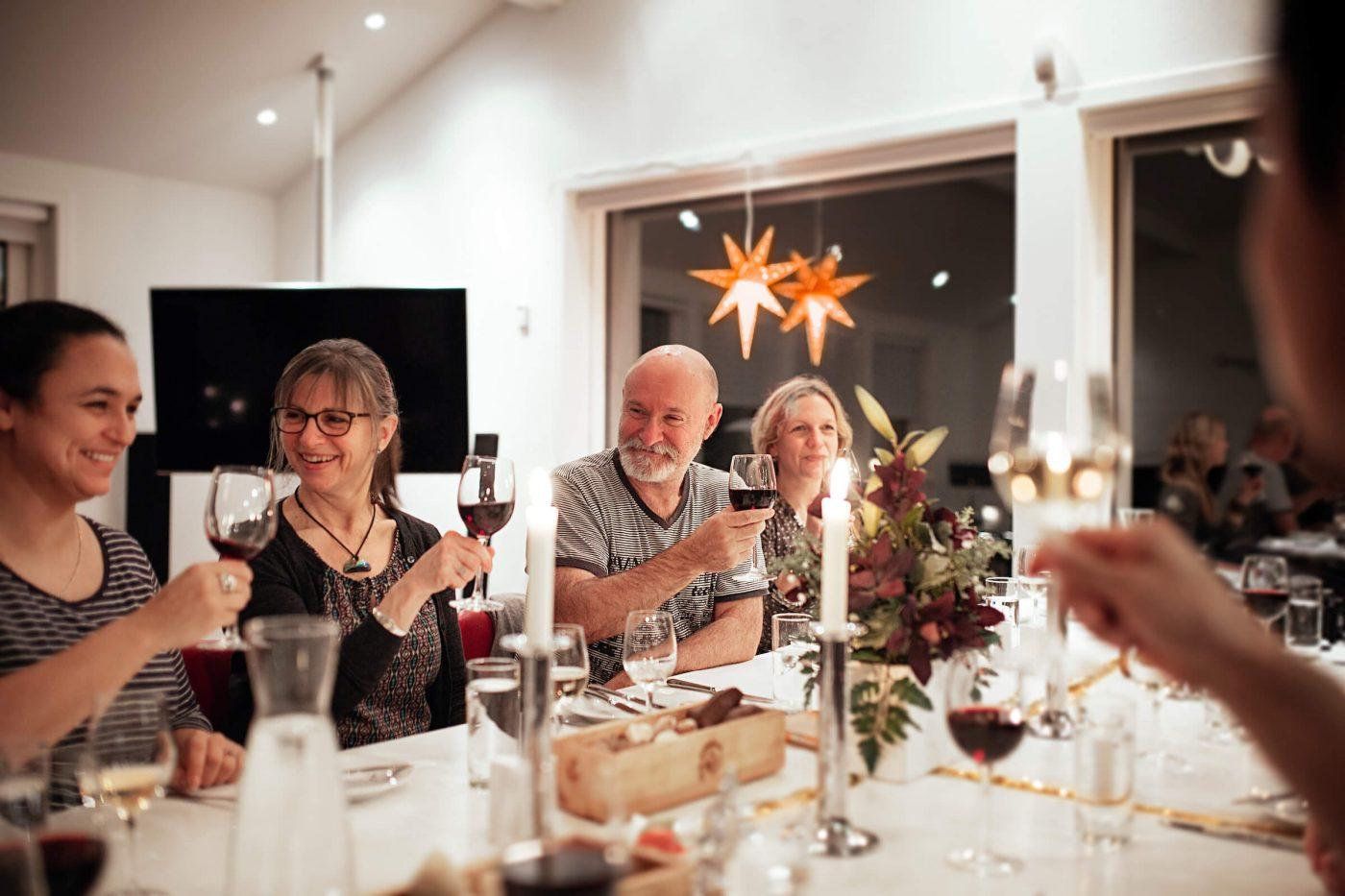 Locals and tourists toasting at a christmas dinner in Nuuk in Greenland. Photo by Rebecca Gustafsson