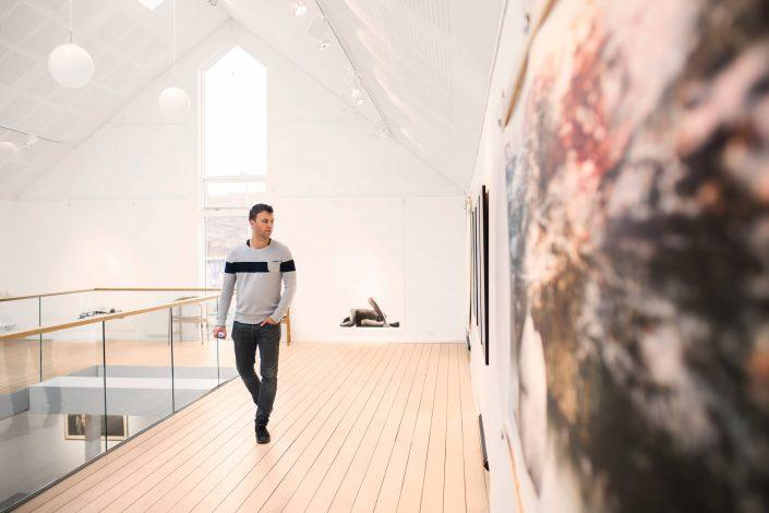 Man looking at art in Nuuk Art Museum. By Rebecca Gustafsson