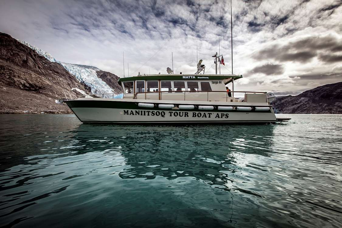 "Maniitsoq Tour Boat flagship ""Matta"" in the Eternity Fjord in Greenland. Photo by Mads Pihl - Visit Greenland"