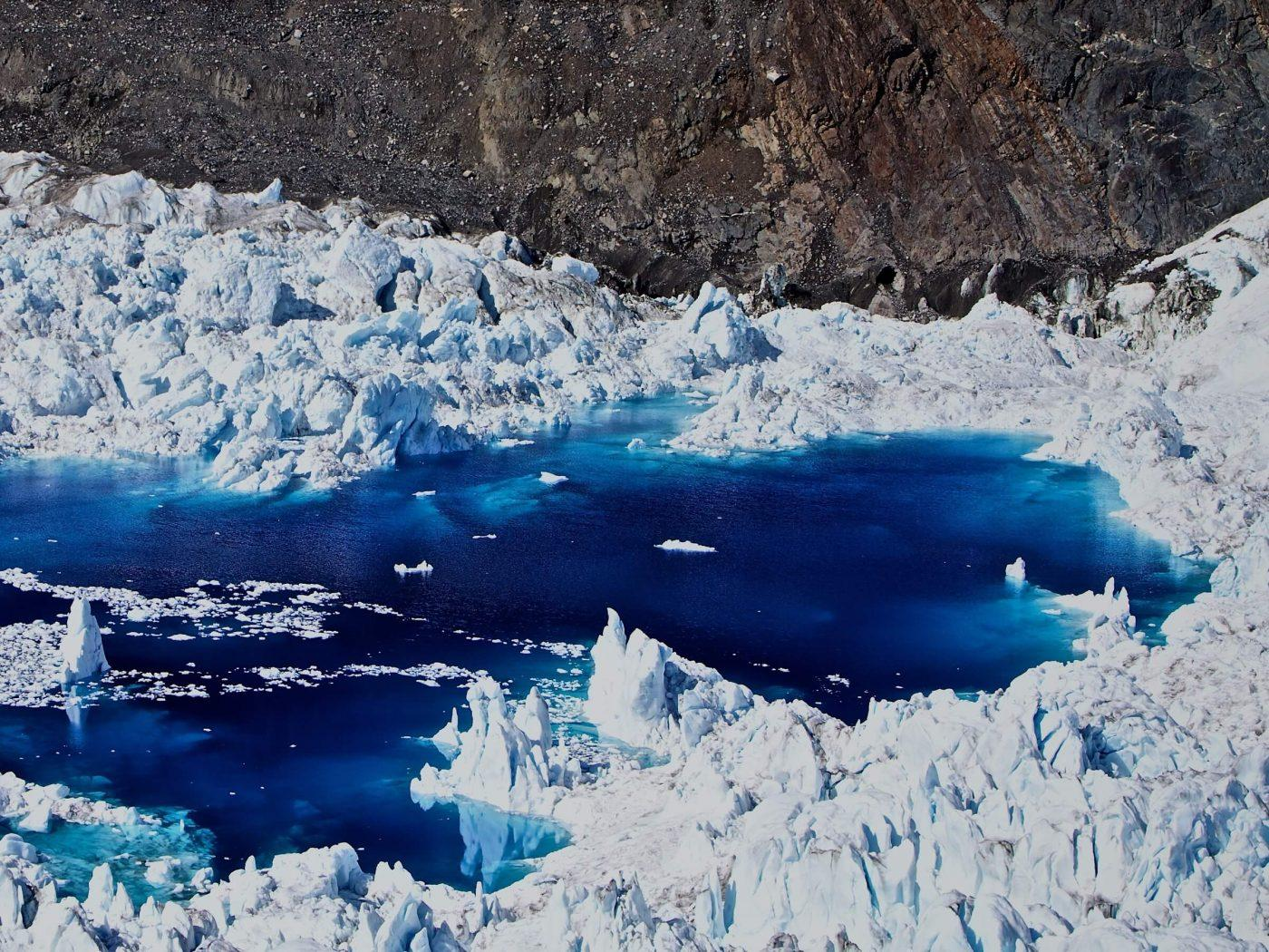 Meltwater lake at the Greenland ice cap, by Ace and Ace