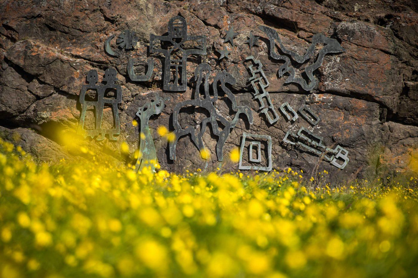 Modern day cast iron norse runes on a rock wall in Qassiarsuk. By Mads Pihl