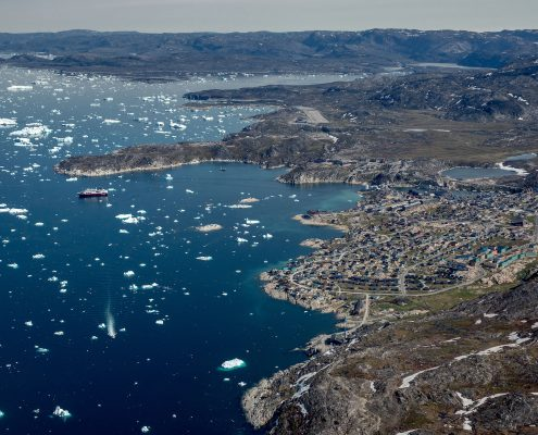 MS Fram anchoring up outside Ilulissat seen from an Air Zafari flight in Greenland. By Mads Pihl