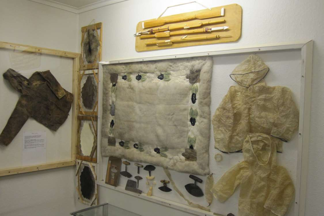 Museal relics from the Inuit culture of Greenland showcasing anorak, uluit, harpoons and crafts of eider feathers and sealskin. Photo by Nanortalik Museum
