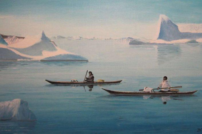 Painting of two men in anorak hunting in kayaks with icebergs in both back- and foreground. Photo by Nanortalik Museum