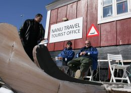 Three men enjoying the sun in front of Nanu Travel Tourist Office. Photo by Nanu Travel