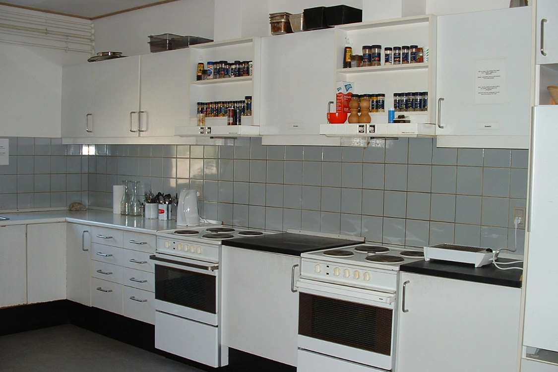 Kitchen area with two stoves in Narsarsuaq Hostel. Photo by Blue Ice Explorer