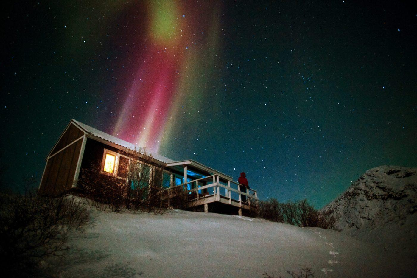 Northern Lights over a hut in the Kangerlussuaq backgrountry in Greenland. By David Trood