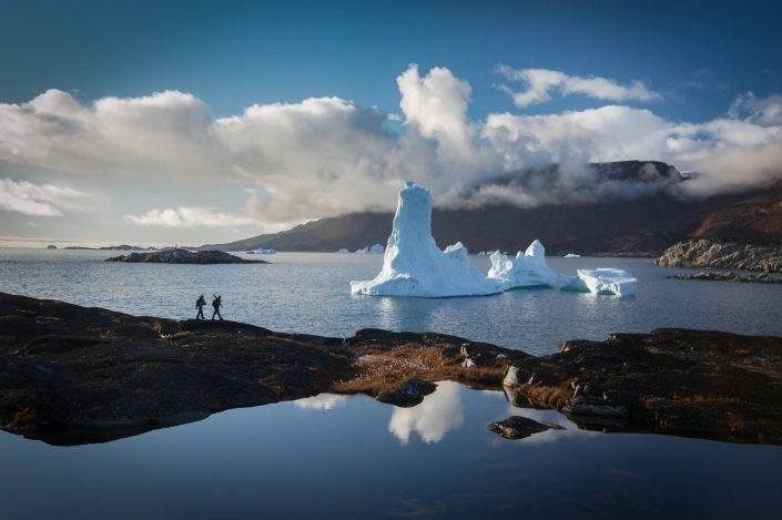 Photographers hiking for the perfect photo stop by the Ilulissat icefjord in North Greenland. By Paul Zizka