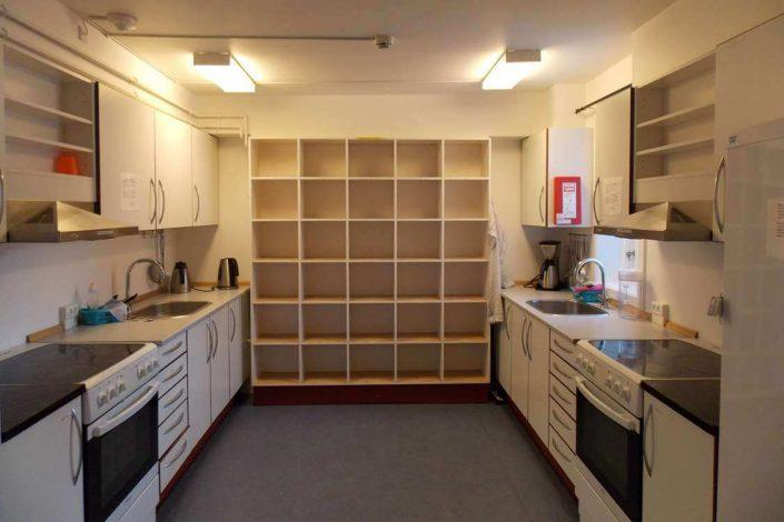 Communal kitchen with lots of room for storage. Photo by Sisimiut Youth Hostel, Visit Greenland