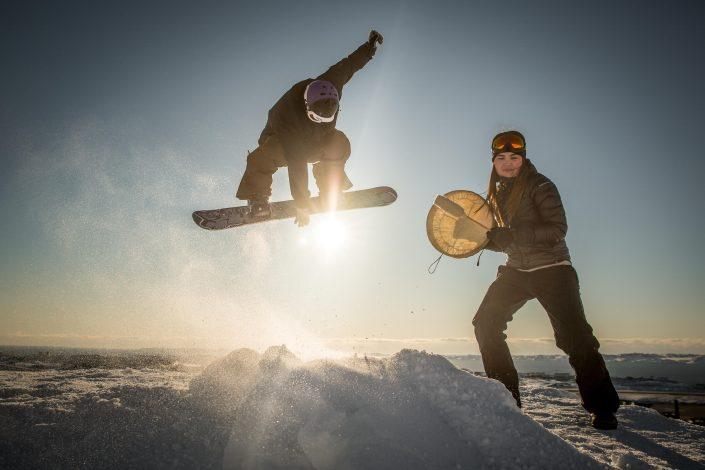 Snowboarding and drum dancing meet up at the snow park in Nuuk in Greenland before the Arctic Winter Games. Photo by Mads Pihl