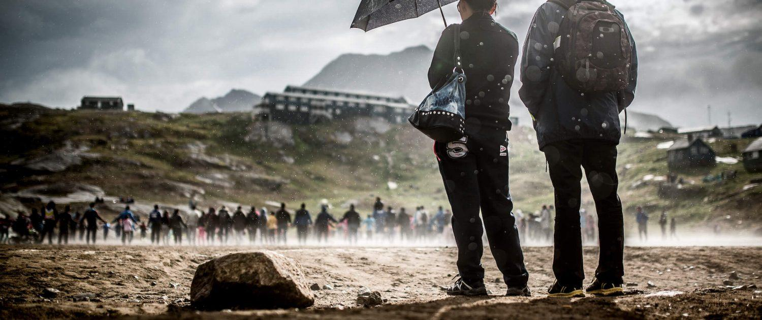 Spectators watch the post match celebrations of a soccer game at the 2013 East Greenland championships in Tasiilaq. By Mads Pihl