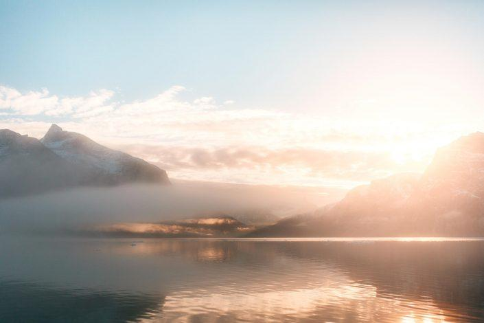 Sunrise over the mountains in the Nuuk fjord in Greenland. Photo by Rebecca Gustafsson