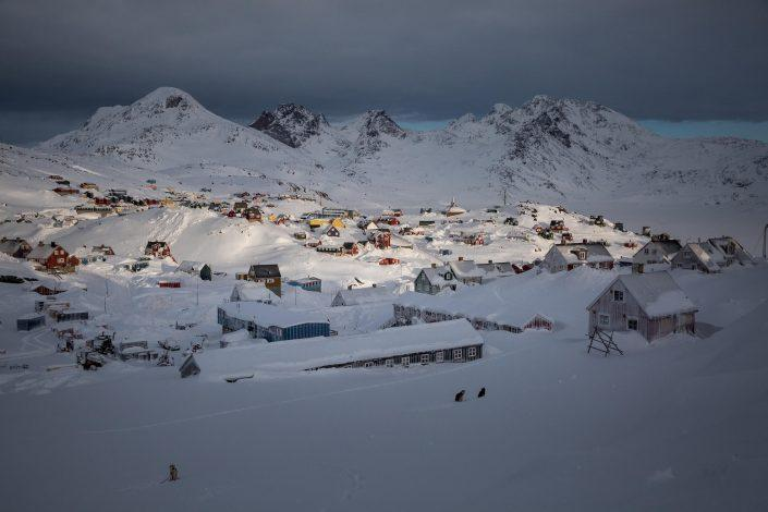 A winter sunrise over Tasiilaq in East Greenland