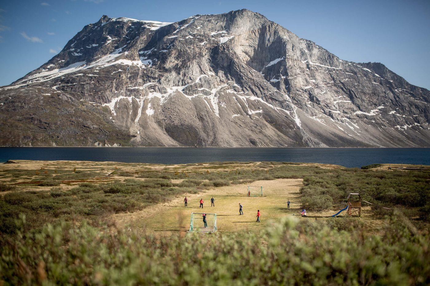 The backcountry soccer or football field at Qooqqut in the fjord near Nuuk in Greenland. Photo by Mads Pihl