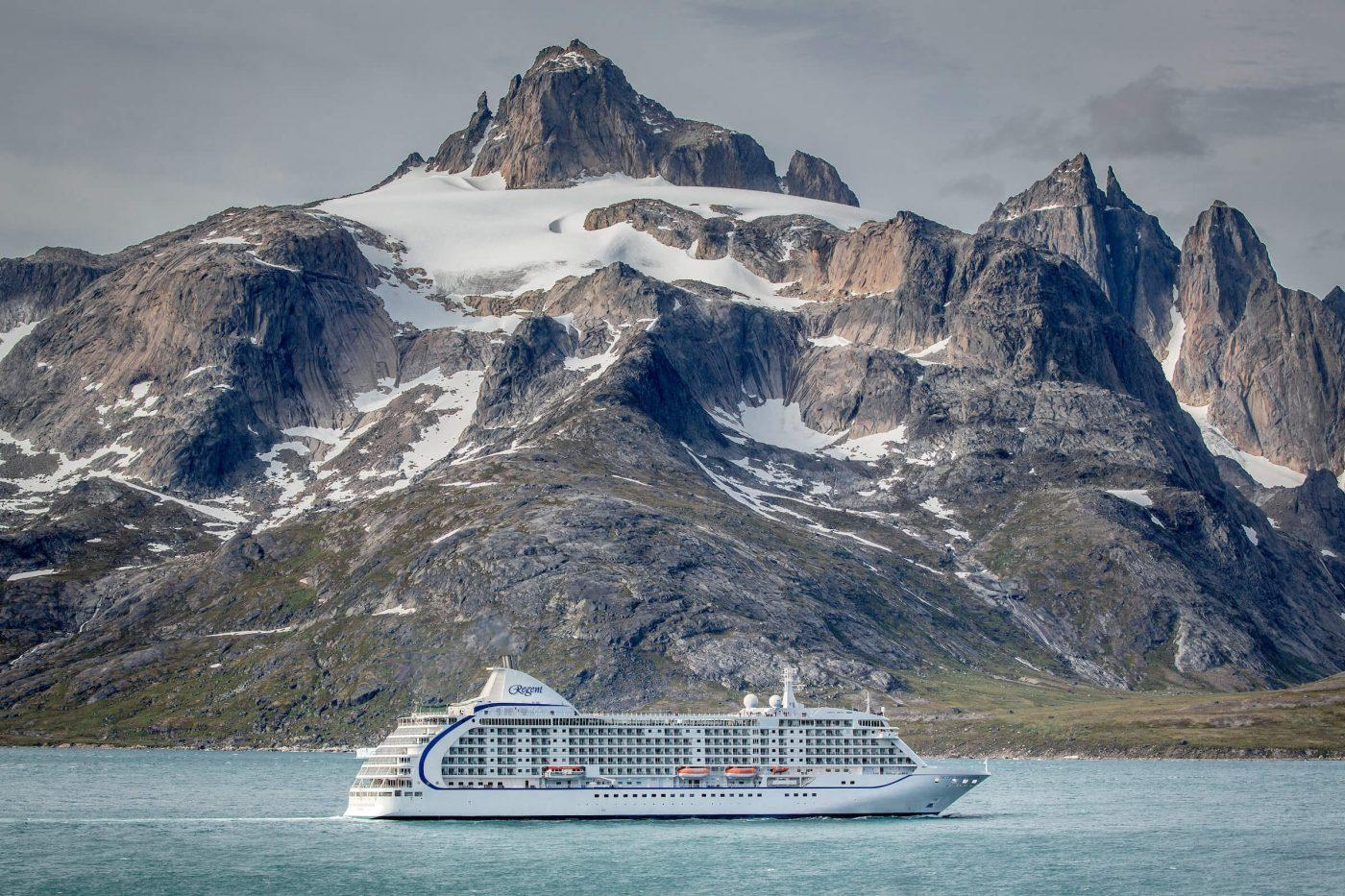 The cruise ship Sevens Seas Voyager passes underneath the mountain Qilertiki in South Greenland near Aappilattoq and Prince Christian Sound. Photo by Sevens Seas Voyager