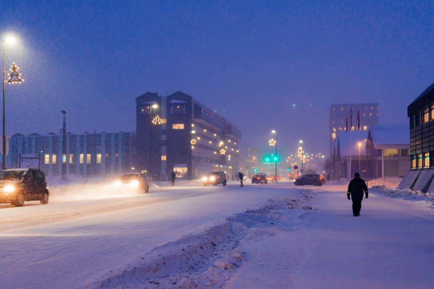 The main road of Nuuk during a snowy afternoon in December, decorated with christmas lights, by Rebecca Gustafsson