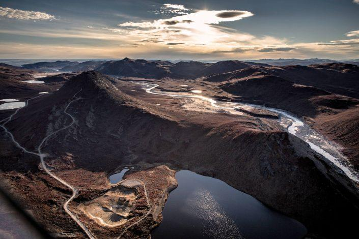 The morning sun coming up over the vealleys around Kangerlussuaq in Greenland seen from an Air Zafari flight. By Mads Pihl