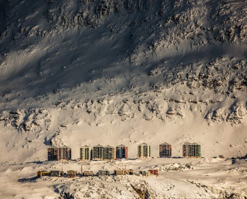 The Suloraq towers in Nuuk's suburb Qinngorput nestled below the mountain Ukkusissaq in Greenland