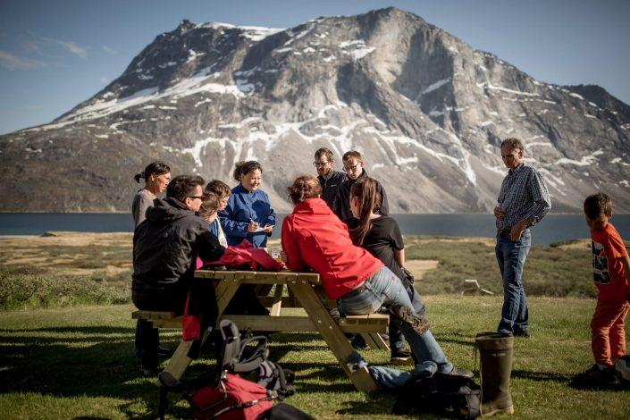 The waiter taking orders from guests at the Qooqqut Nuan restaurant in the fjord near Nuuk in Greenland. Photo by Mads Pihla