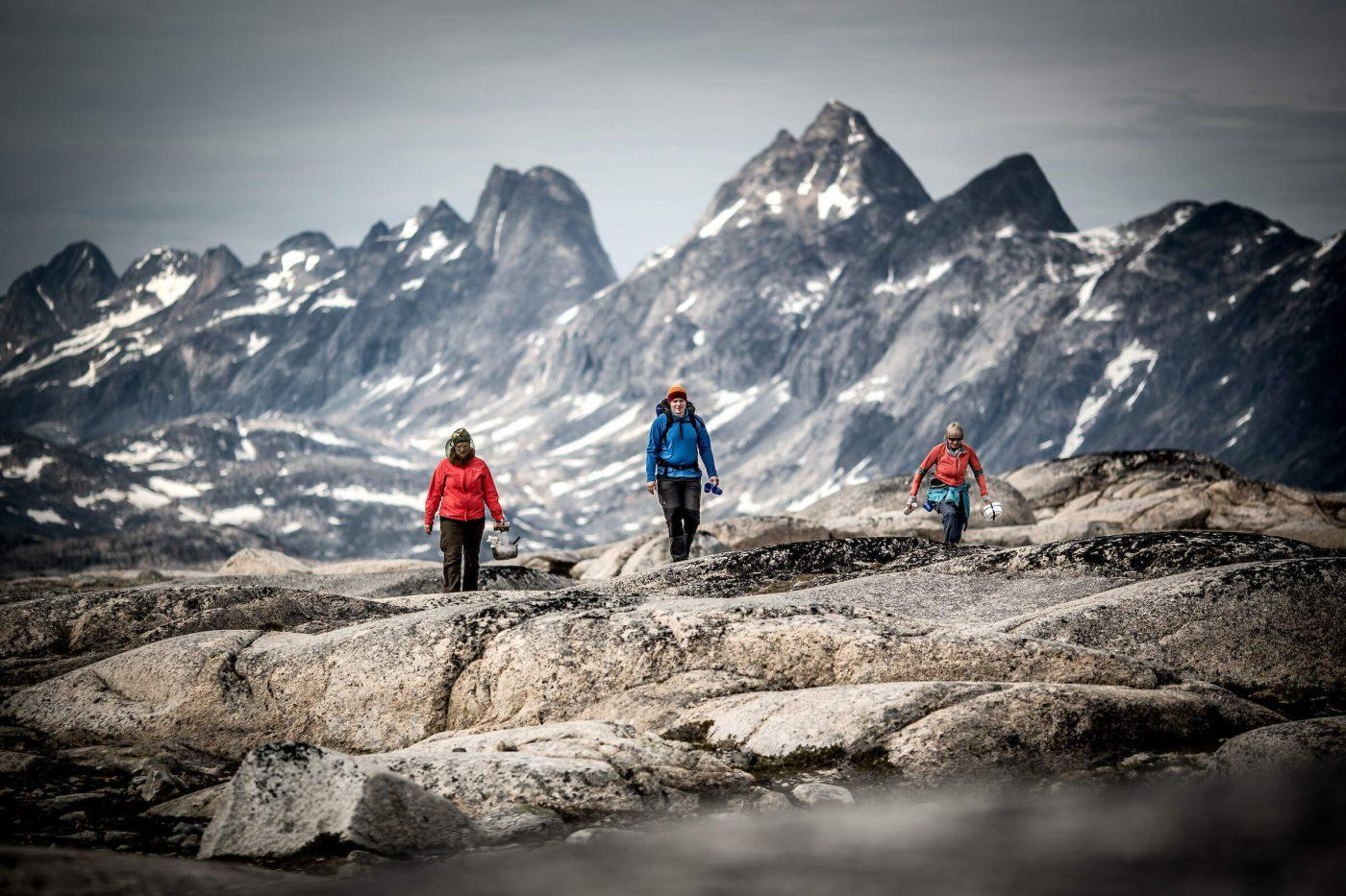 Three hikers in the mountains near Qernertivartivit not far from Kulusuk in East Greenland. By Mads Pihl