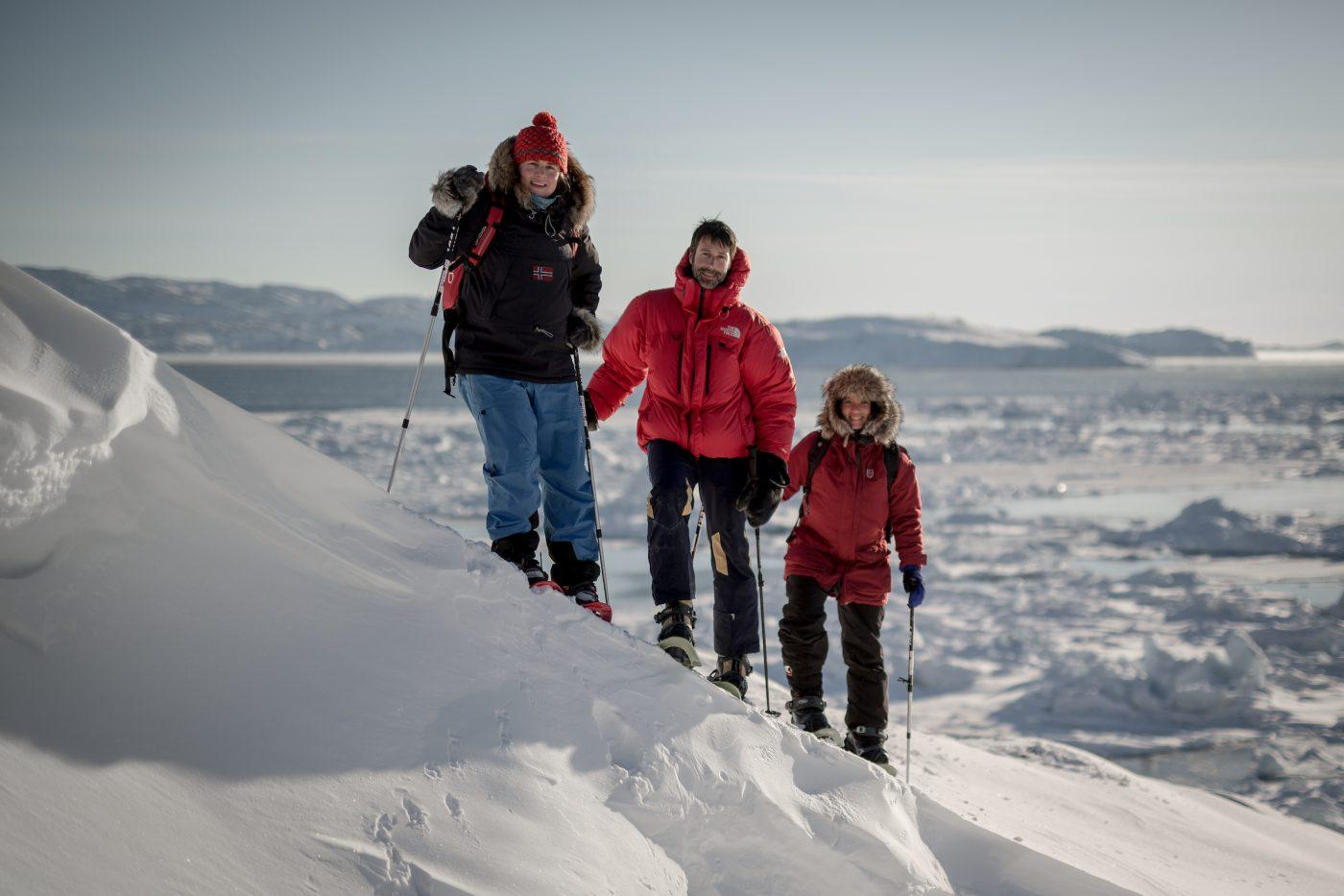Three snowshoers on a PGI Greenland snowshoe trip near Ilulissat in Greenland. By Mads Pihl