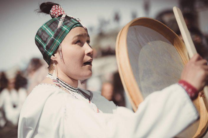 Traditional Dress - A drum dancer performing in Nuuk on National Day in Greenland