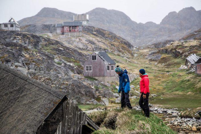 Travelers in Nuuk visit the abandoned settlement of Kangeq while on a boat tour with Touring Greenland. By Raven Eye Photography