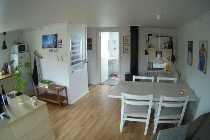 Cozy living area with open kitchen and dining area. Photo bt Arctic Dream, Visit Greenland