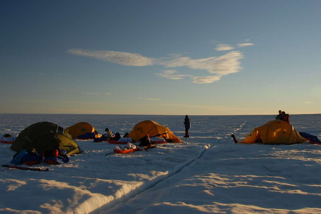 Set up camp on a large open field of icesheets. Photo by Arctic Dream, Visit Greenland