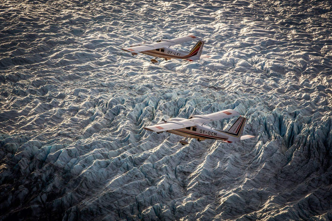 Two Air Zafari flightseeing planes over the Greenland Ice Sheet near Kangerlussuaq Airport. By Mads Pihl