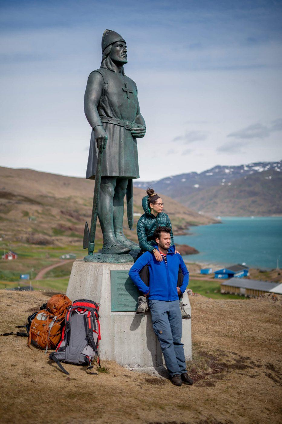 Two travelers at the Leif Ericson statue in Qassiarsuk in South Greenland. By Mads Pihl