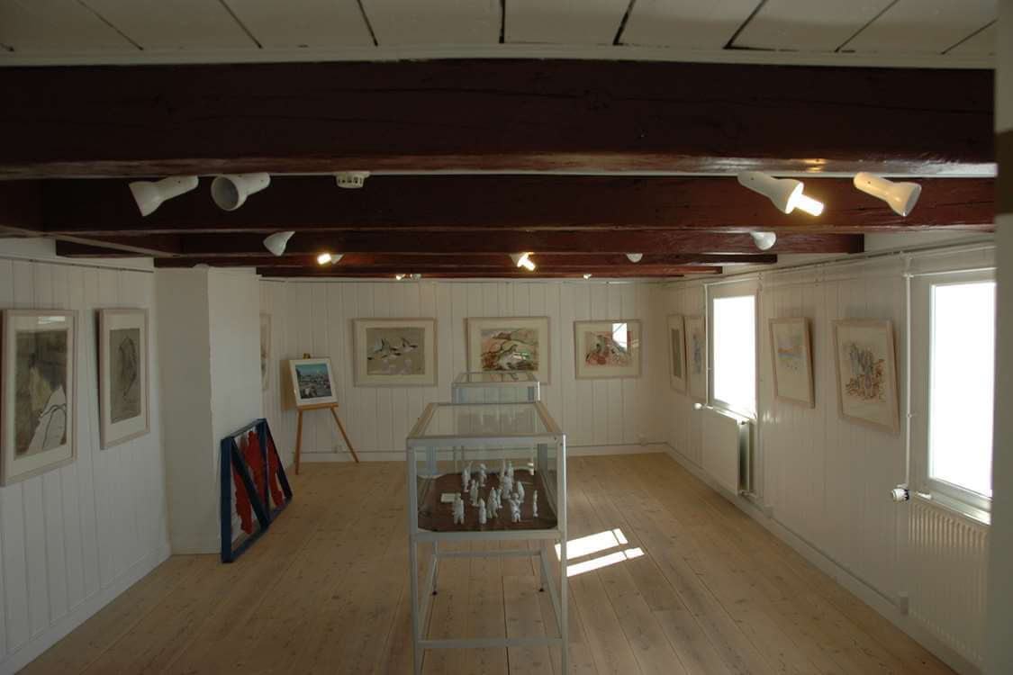 Exhibition of paintings by Gitz Johansen and figures by Otto Thomassen. Photo by Upernavik Museum, Visit Greenland