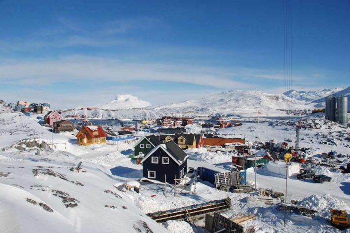 View over snowy mountains and parts of Nuuk. Photo by vandrehuset.com, Visit Greenland