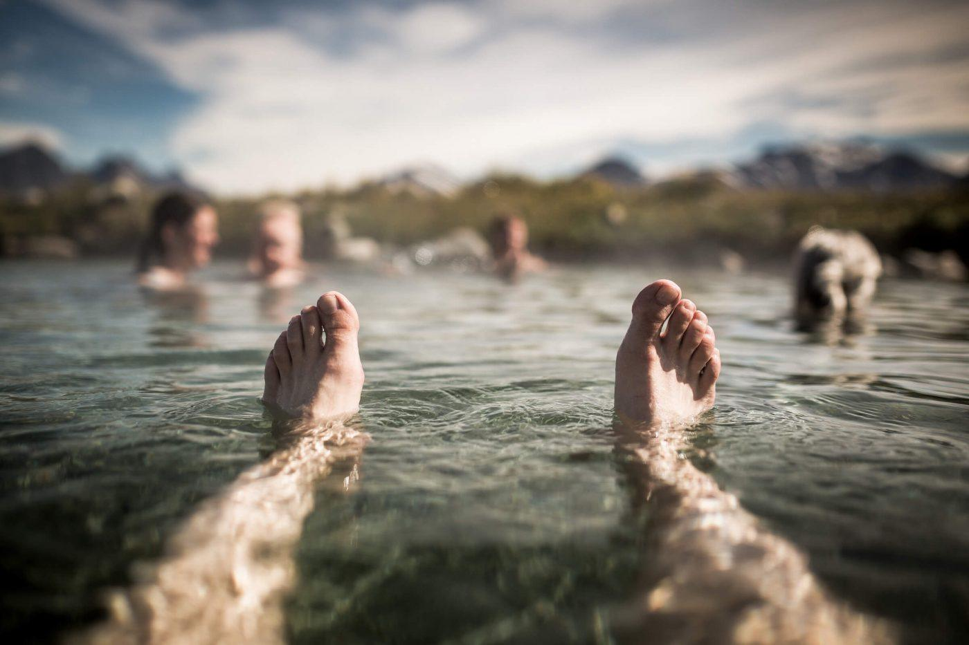 With the feet up and enjoying the hot springs at Uunartoq in South Greenland. By Mads Pihl