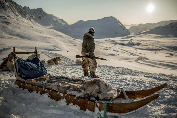 A hunter from Sisimiut with his team of dogs in the backcountry near Sisimiut in Greenland. By Mads Pihl