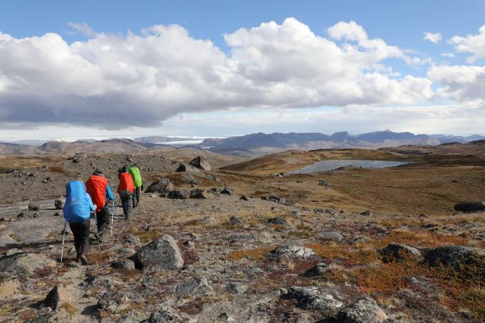 Hikers hiking in Aasivissuit UNESCO area close to Kangerlussuaq in summer. Photo by Morten Christensen - Visit Greenland