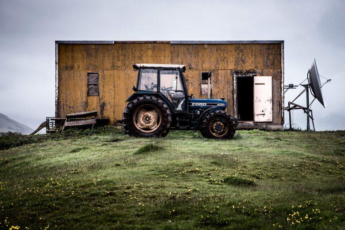 A tractor parked in front of an outbuilding in Qassiarsuk in South Greenland. Photo by Mads Pihl.