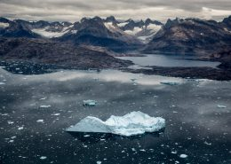Giant iceberg close to the village Tiniteqilaaq in East Greenland. By Mads Pihl