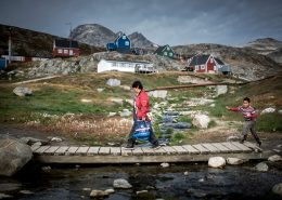 A mother and her son walking home from the grocery store Pilersuisoq in Kuummiut, East Greenland. By Mads Pihl