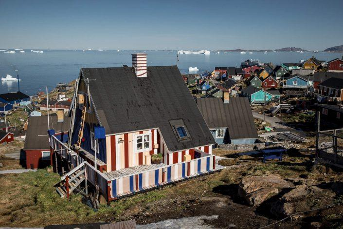 A striped and colourful house in Upernavik in Greenland. Photo by Mads Pihl.