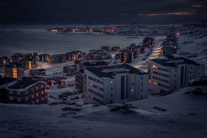 A winter night view from Qinngorput towards Nuuk in Greenland. By Mads Pihl