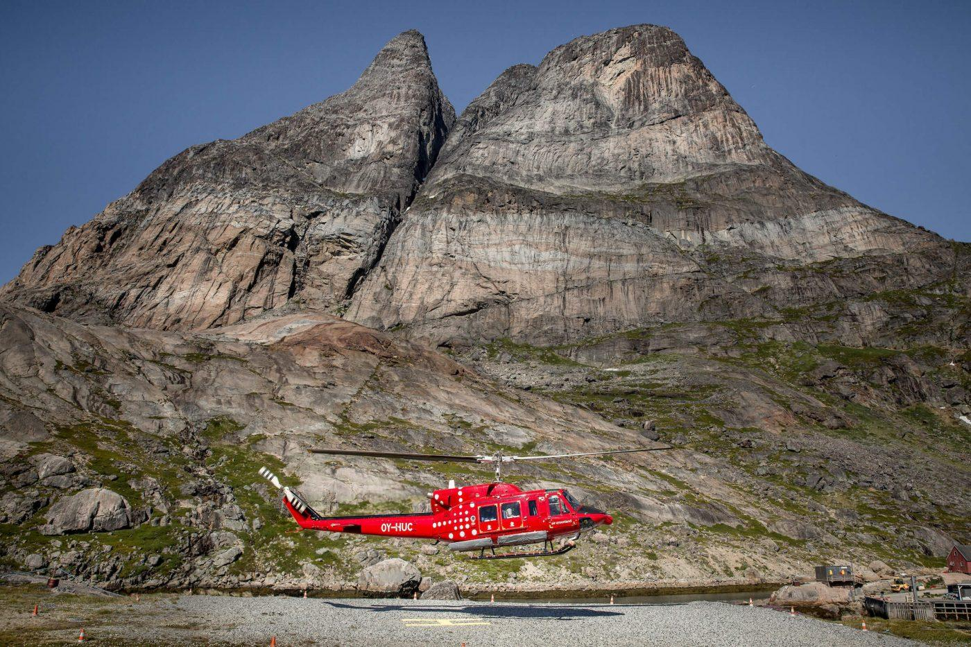 An Air Greenland Bell 212 passenger helicopter taking off from Aappilattoq in South Greenland. Photo by Mads Pihl, Visit Greenland