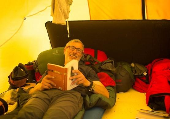 Manuel, or Mannu, as he is called in Greenland, reading in the resting tent one day when we had a stop. By Malik Milfeldt