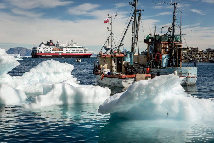 Fishing boats and MS Fram in Uummannaq in Greenland. Photo by Mads Pihl.