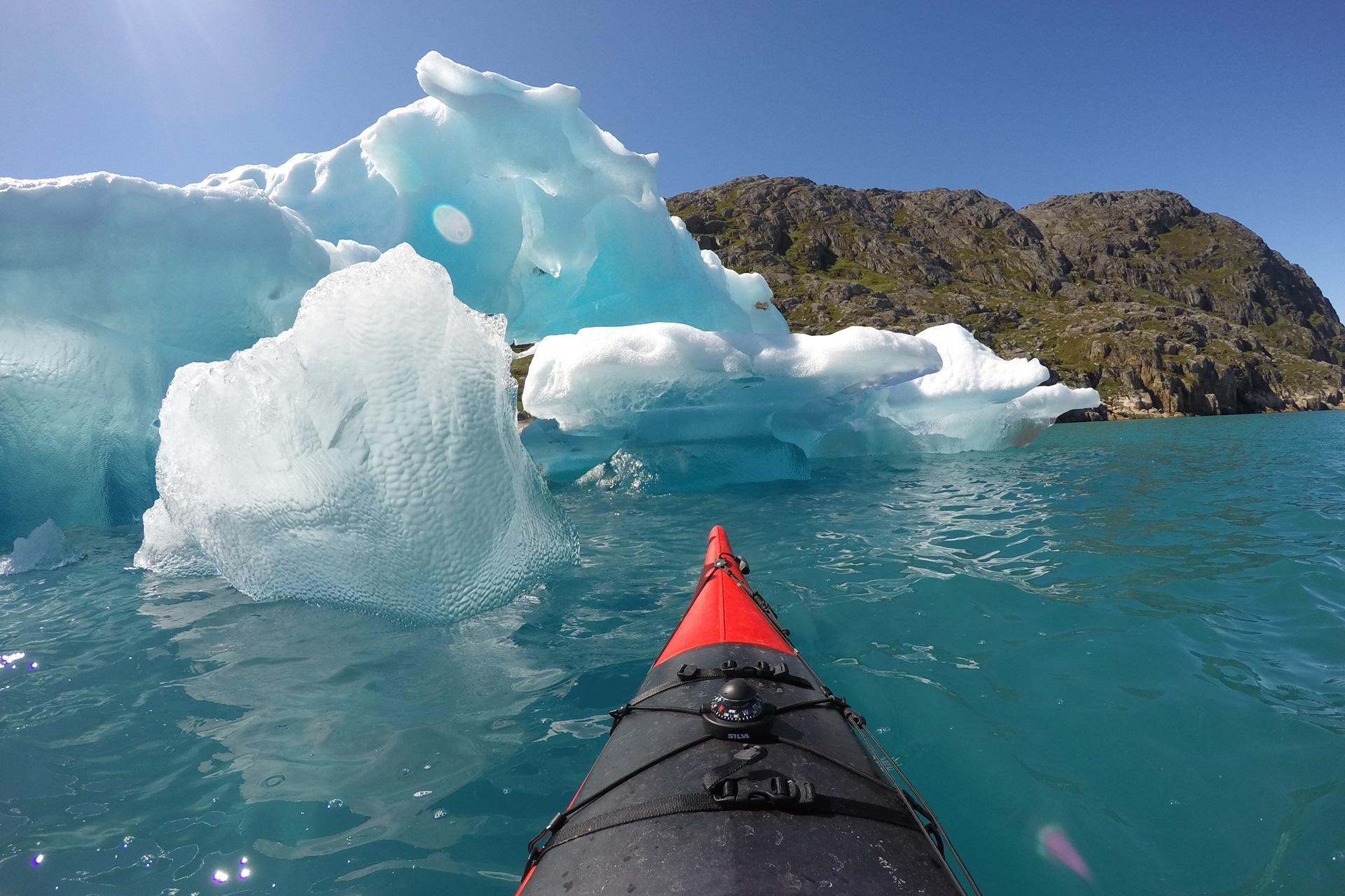 Kayak at Ice. By Visit Greenland